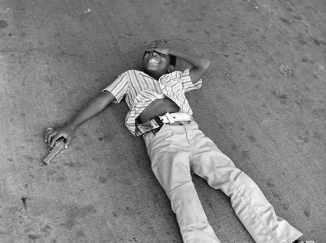 Young black man pretending to be shot, Uptown, Chicago, mid-1970s.