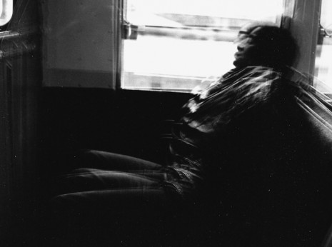 Photo of man asleep on elevated train, Uptown Chicago, mid-1970s.