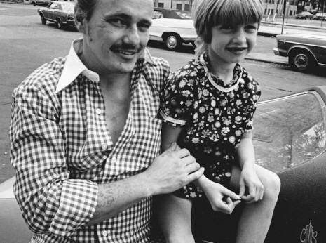 Image of Father and Daughter Sitting on Car taken in the Uptown neighborhood of Chicago in the mid-1970s.