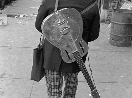 Street Musician with Guitar on Back