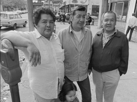 Three men outside of a Greek Bar called Zorbas at the corner of Wilson and Kenmore in Chicago during the mid-1970s.