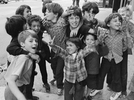 Crowd of exited kids, many with roller skates, on Wilson Avenue in 1974.