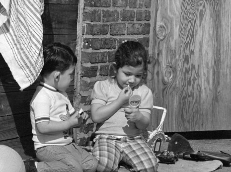 Kids playing in alley behind Guatemala Cafe in Uptown, 1975.