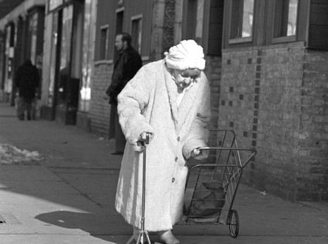 Elderly woman in White with Cane