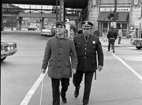 Cop Helping Blind Man Across Broadway and Wilson