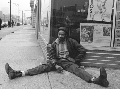 Man Relaxing at the Corner of Wilson and Broadway, 1975
