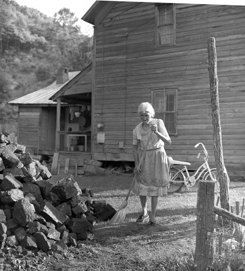 Woman Dusting Coal Off Path